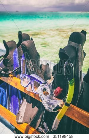 Snorkel fins and mask on cruise excursion snorkeling from boat in exotic ocean summer vacation travel holiday. Watersport activity.