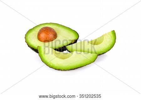 Cut Ripe Avocado With Seed On White Background