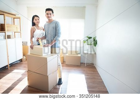 Asian Couple Receive Shipment From Delivery Man, Order Box Shipping From Online Store Website To Del