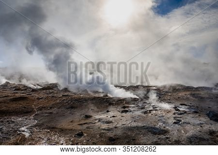 Namafjall Hverir Geothermal Area In Iceland. Stunning Landscape Of Sulfur Valley With Smoking Fumaro