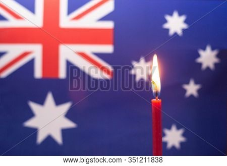 Burning Candle On The Background Of The Flag Of Australia. The Concept Of Mourning And Sorrow In The