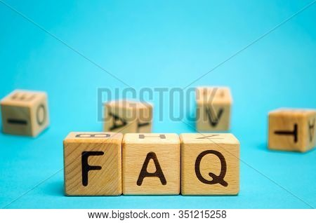 Wooden Blocks With The Word Faq (frequently Asked Questions). Collection Of Frequently Asked Questio