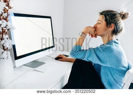 Side View Image Of Freelancer Businesswoman Using A Desktop Computer In An Office. Young Blonde Woma