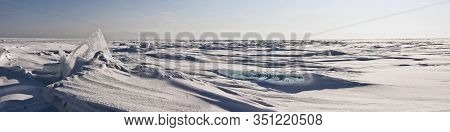 Transparent Ice Hummock In The Snow On Lake Baikal In Siberia, Russia. Wide Panorama Background