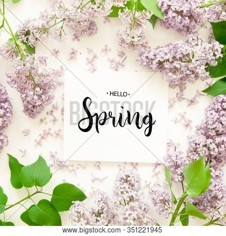 Inscription Hello Spring. Lilac Flowers On White Background. Spring Flowers. Top View, Flat Lay. - I