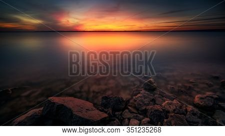 Colorful Sunset Over Benbrook Lake In North Texas, Long Exposure