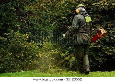 Agricultural Worker With Strimmer