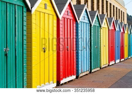 Beautifully Coloured Beach Huts On The Promenade At Boscombe Beach On The South Coast Of The Uk