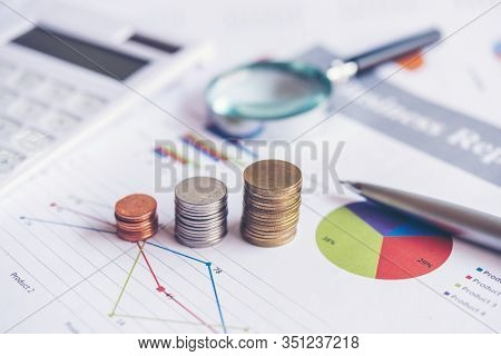 Growth Economic On Stack Of Coins On Report Paper Analyze Performance Financial Graph Funding With C