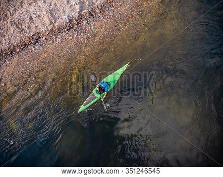 Guy In Kayak Sails Mountain River. Whitewater Kayaking, Extreme Sport Rafting. Aerial Top View