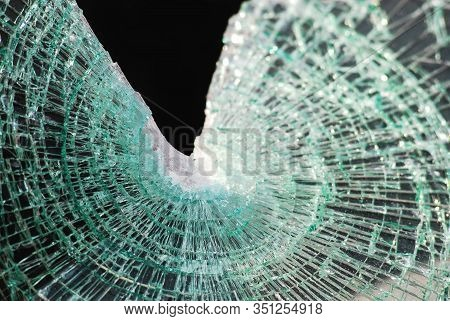Shattered Laminated Glass From A Windshield Display Classic Spider Web Cracking After Impact With A