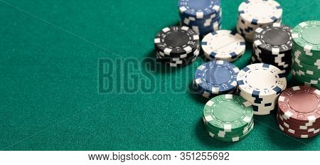 Poker Table In Casino Top View. Green Table With Poker Chips, Background With Copy Space.
