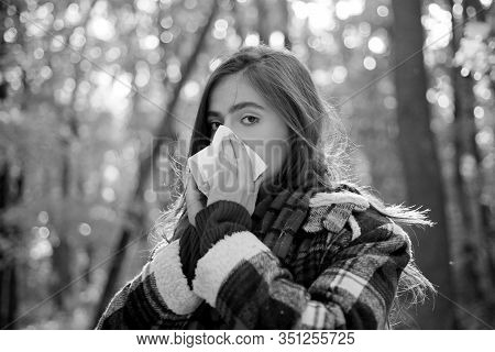 Woman With Napkin Sneezing In The Yellow Park. Sick People Has Runny Nose. Allergy Season. Woman Mak