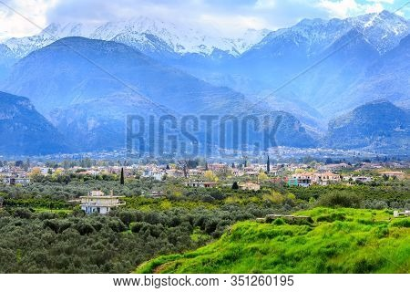 Aerial Panoramic View Of Sparta City With Taygetus Mountains And Ancient Ruins Remains In Peloponnes