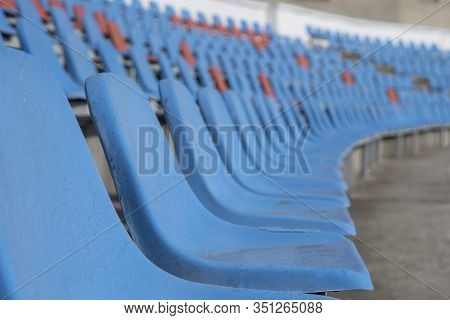 Seats In The Stadium-background. Auditorium-stands. Rows Of Chairs In An Open-air Stadium. Spectator