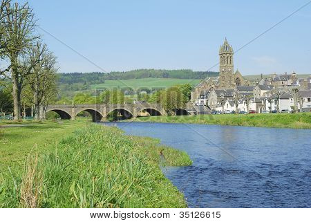 Stone Bridge Over River Tweed And Church Tower At Peebles