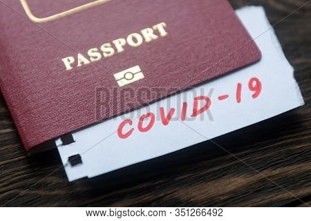 Coronavirus And Travel Concept. Note Covid-19 Coronavirus And Passport. Novel Corona Virus Outbreak.