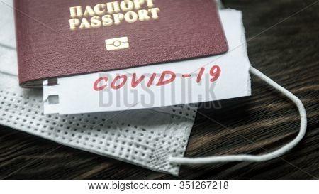 Coronavirus And Travel Concept. Note Covid-19 Coronavirus, Passport And Mask. Corona Virus Outbreak,