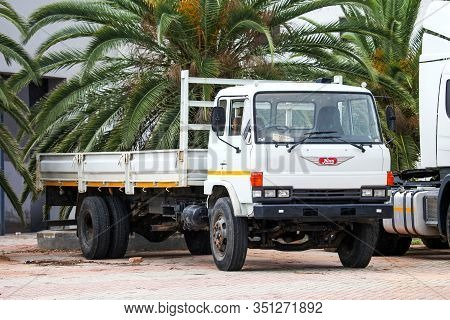 Tsumeb, Namibia - February 7, 2020: Old Flatbed Truck Hino Ranger On The Town Street.