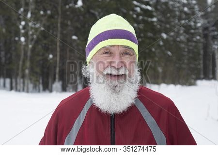 Portrait Of An Elderly Man Who Runs In The Woods. Active Longevity.