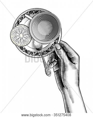 Female hand holding a cup with tea and a small spoon on a saucer with a lemon slice. Vintage engraving black and white stylized drawing