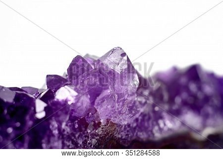 Amethyst Crystals Geode Isolated On White Background. Stock Photo