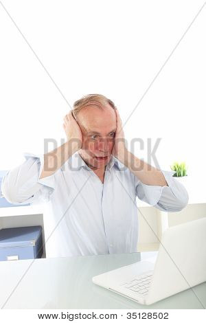 Man Reacting In Shock To His Laptop