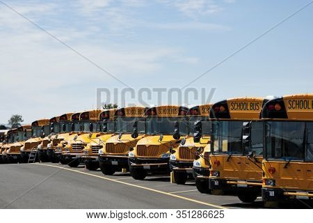 A Row Of Parked, Public School Busses