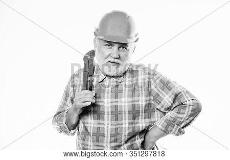 Man Bearded Plumber Wear Helmet And Hold Wrench Tool. Repair Concept. Sanitary Engineering. Plumber