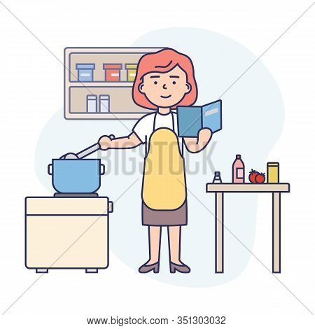 Cooking Concept. Happy Woman Is Cooking Food At Kitchen. Woman Is Reading The Recipe, Cooking And Ha