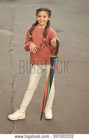 Girl Child Long Hair Ready Meet Fall Weather With Folded Umbrella. Carefree Weekend Walk. Fall Seaso