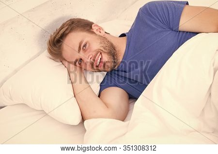 Experiencing A Supreme Pleasure. Single Man Smiling After Waking Up In Morning. Single Person Lying