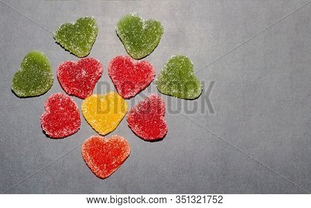 Marmalade Multi-colored Sweets In The Shape Of A Heart Are Laid Out In The Shape Of A Flower. Marmal