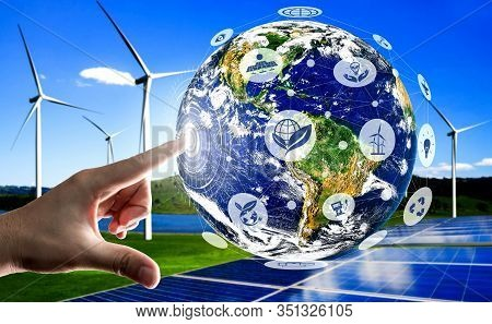 Concept Of Sustainability Development By Alternative Energy. Man Hand Take Care Of Planet Earth With