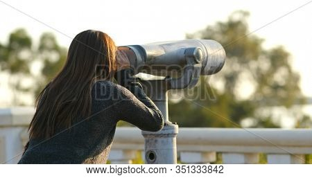 Travel woman look tough the binocular at outdoor