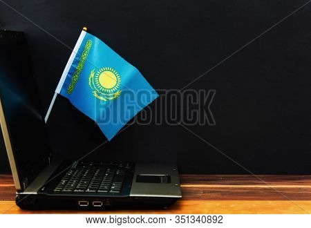 Flag Of Kazakhstan , Computer, Laptop On Table And Dark Background