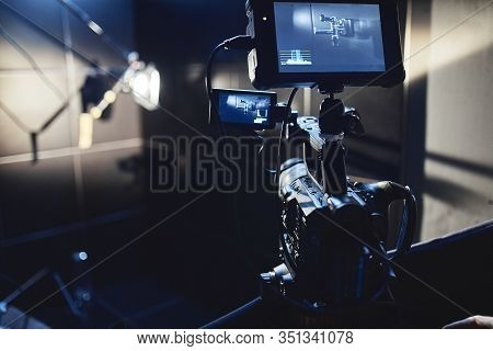 Video Production Backstage. Behind The Scenes Of Creating Video Content, A Professional Team Of Came