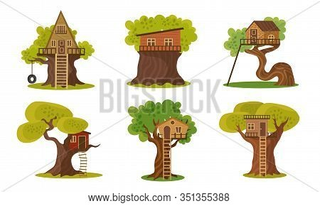 Set Of Different Wooden Houses On Trees Vector Illustration