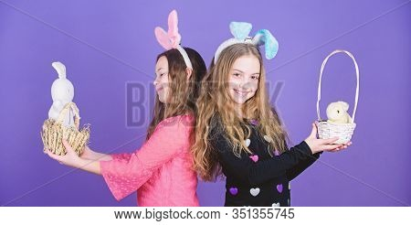Easter Spells Out Beauty. Children Holding Bunny Pets In Easter Baskets. Little Girls Wearing Bunny