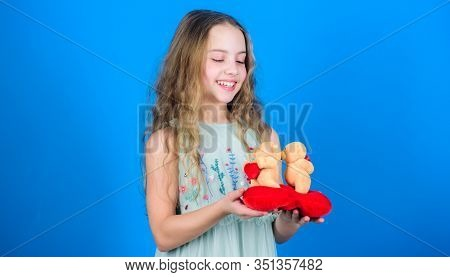 Celebrate Love. Kid Little Girl Carefully Hold Heart Soft Toy Teddy Bear. Small Girl Hold Couple In