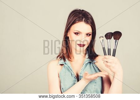 Makeup Cosmetics Concept. Emphasize Femininity. Girl Apply Eye Shadows. Looking Good And Feeling Con