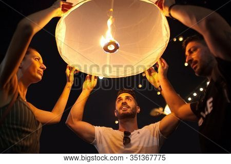 Chiang Mai, Thailand - November 11, 2019: Group Of Young People Releasing Lanterns In Yee Peng Festi