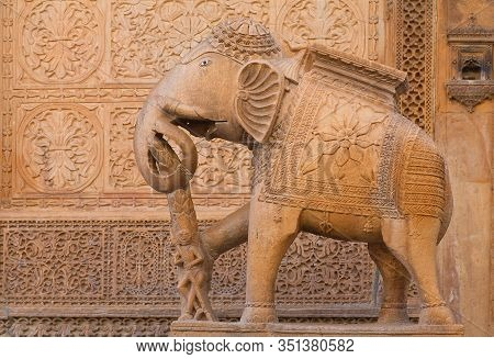 Ancient Sandstone Bas-relief At Nathmal Ki Haveli And Elephant Statue Guard On The Street In Jaisalm