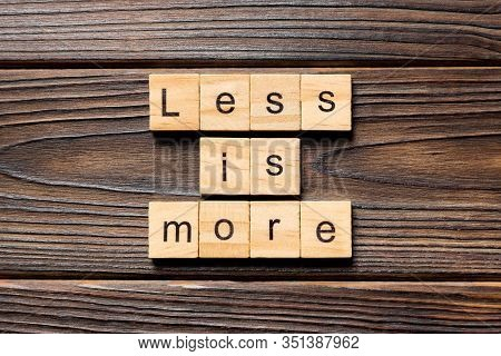 Less Is More Word Written On Wood Block. Less Is More Text On Table, Concept