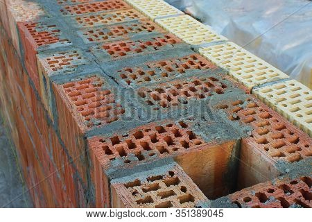 An Exhaust Shaft In A Wall Of Red Brick Filled With Cement. Facing With Yellow And Brown Bricks. Sel