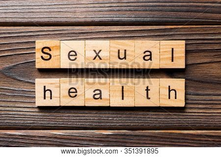 Sexual Health Word Written On Wood Block. Sexual Health Text On Table, Concept
