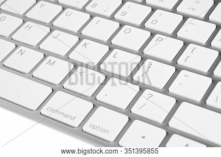 Closeup Of A Modern Computer Keyboard Keys. Close Up View Of A Business Workplace With Wireless Comp