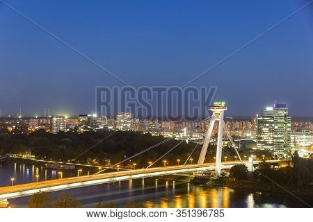 Aerial View Of Danube River And Snp Bridge (also Known As New Bridge And Ufo Bridge) In The Center O