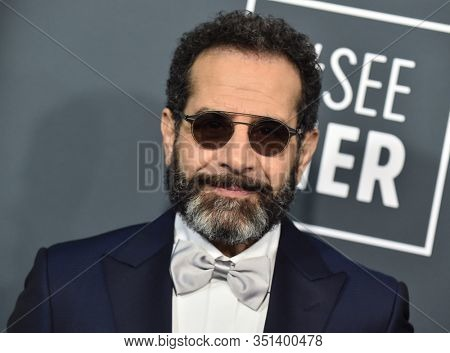 LOS ANGELES - JAN 12:  Tony Shalhoub arrives for the 25th Annual Critics' Choice Awards on January 12, 2020 in Santa Monica, CA