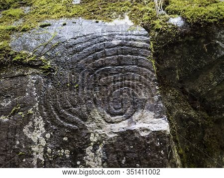 Spiral Petroglyph Carved In Stone In La Zarza Nature Park Archeological Site In Laurel Forest, Lauri
